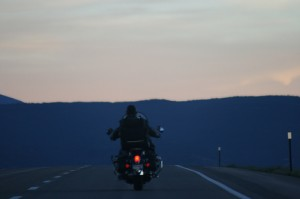 Motorcycle into sunset